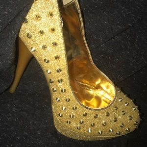 Gold spiked heels. They are posh